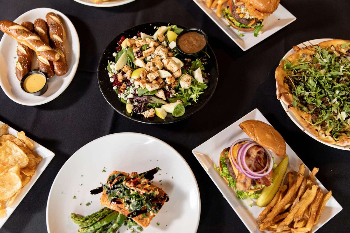overhead shot of several plates of entrees and appetizers