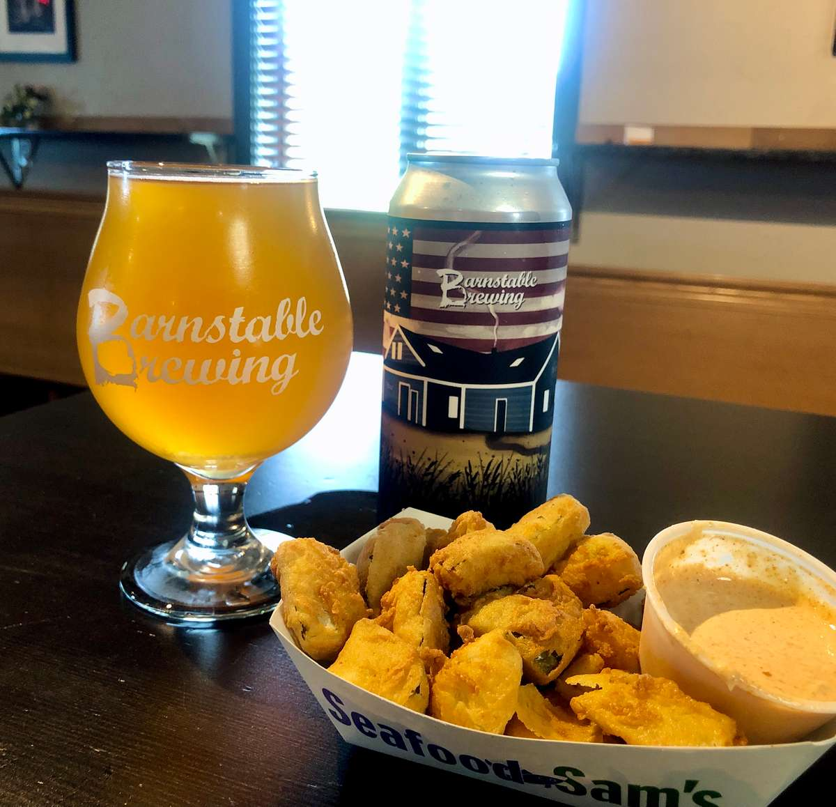 A basket of fried pickle bites paired with Barnstable Brewing's AmeriHop Pale Ale