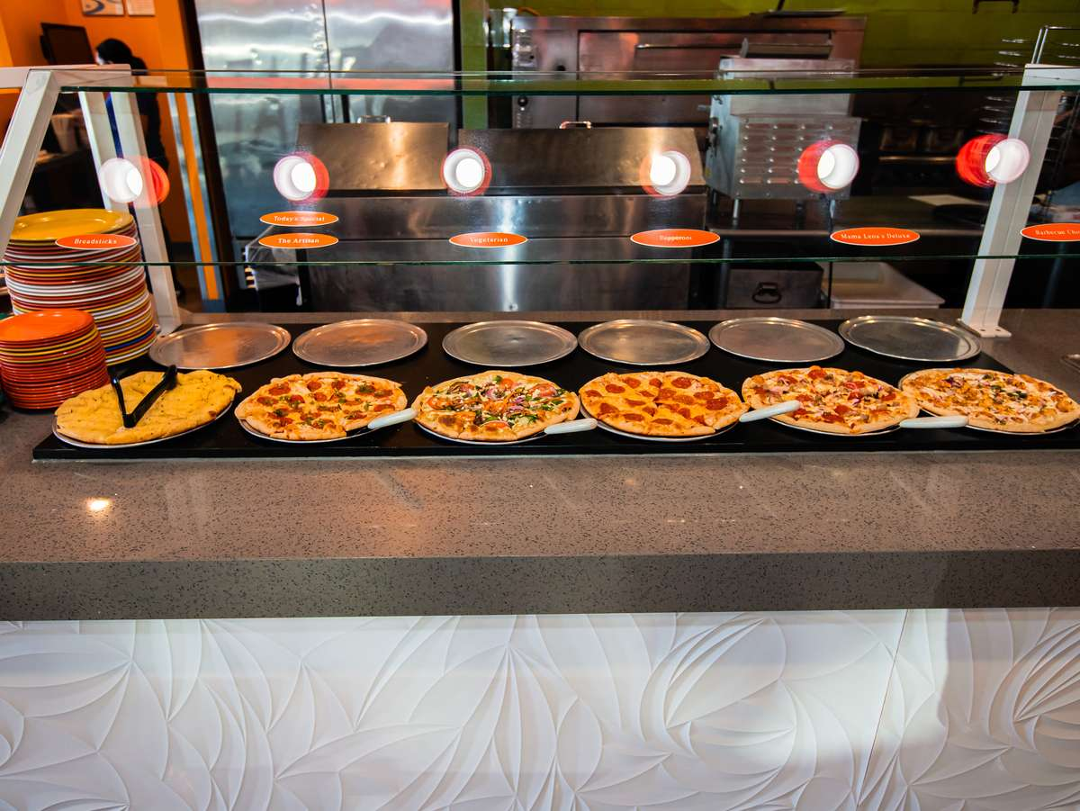 Multiple pizzas at the food bar