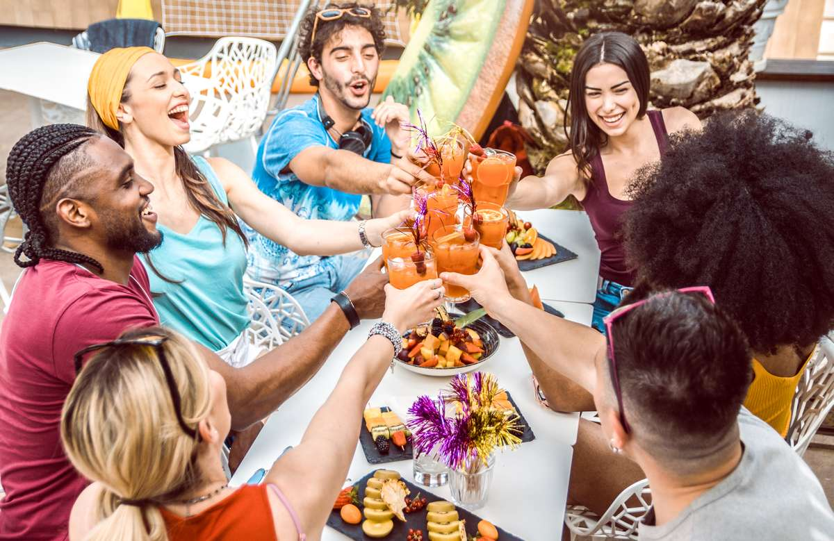 diverse-people-friends-hanging-out-toasting-drinking-cocktails-outdoor