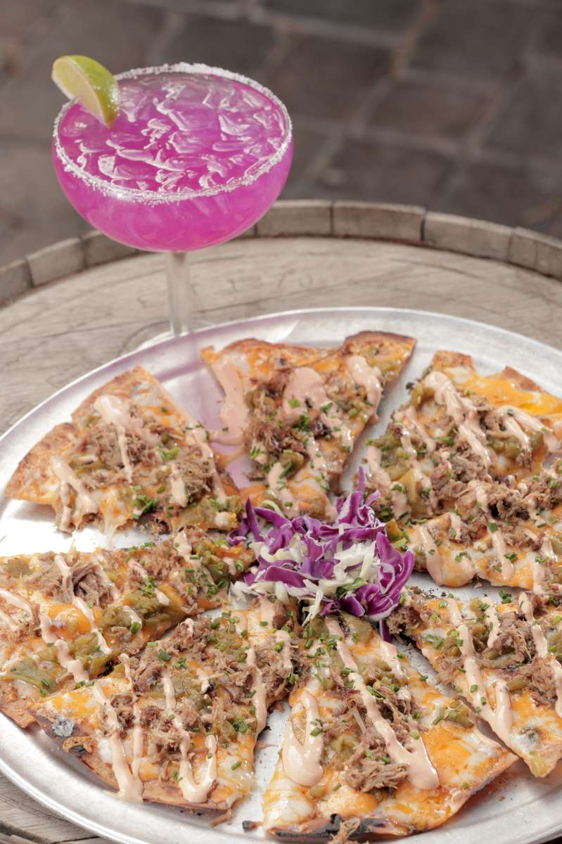 green chile cheese crisp and prickly pear margarita