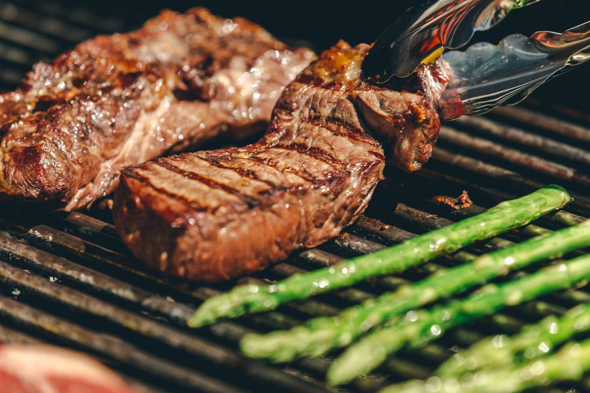 steak and asparagus on a grill