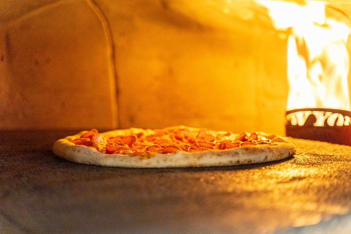 Pizza cooking in oven