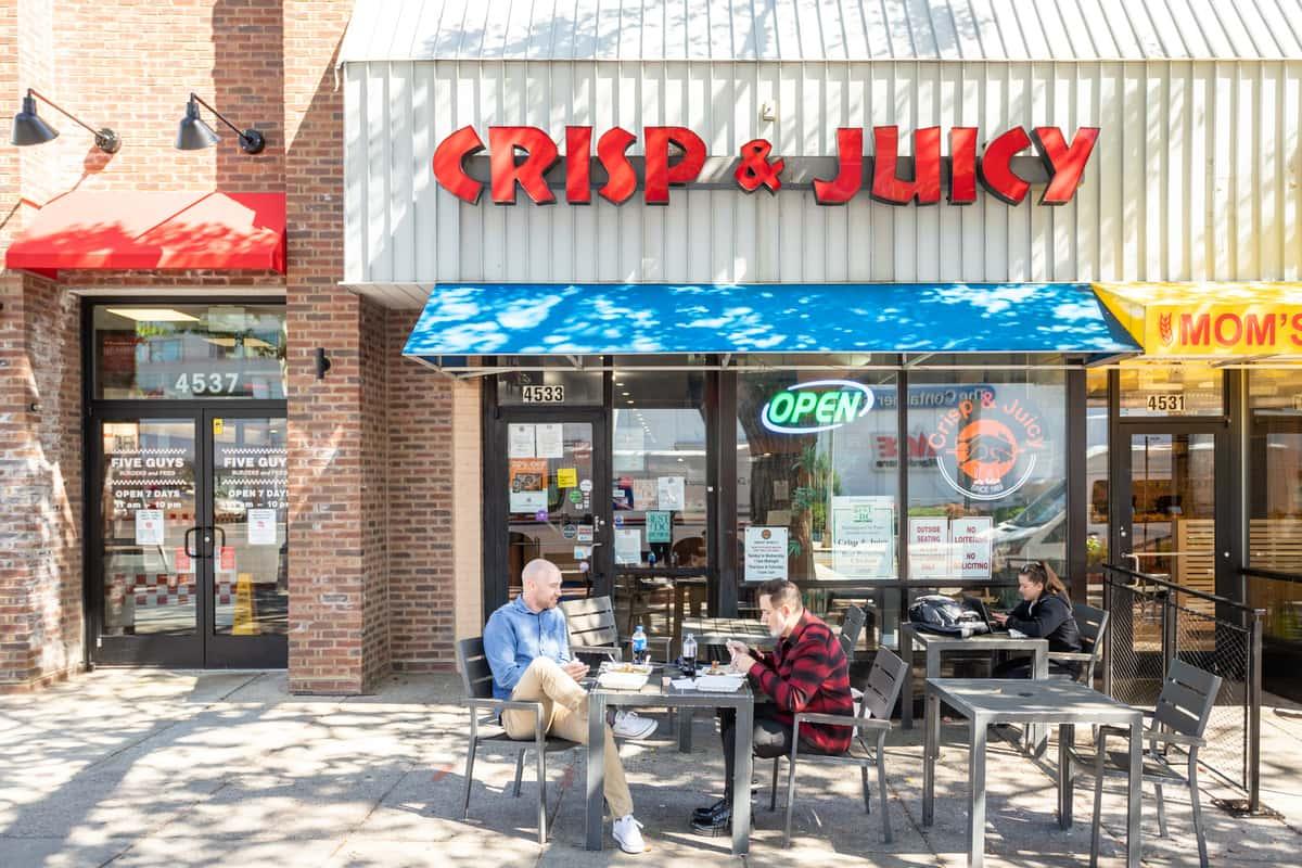 crisp and juicy exterior sign
