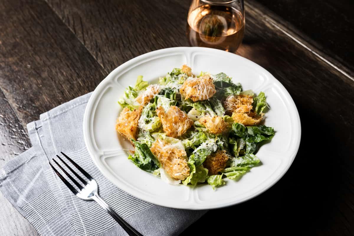 Little Gem Caesar Salad, Caesar Cardini Dressing, Focaccia Croutons, Parmigiano Reggiano