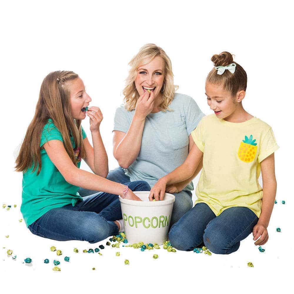 family eating gourmet popcorn