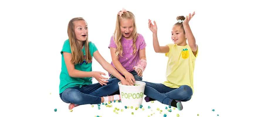 girls eating gourmet popcorn