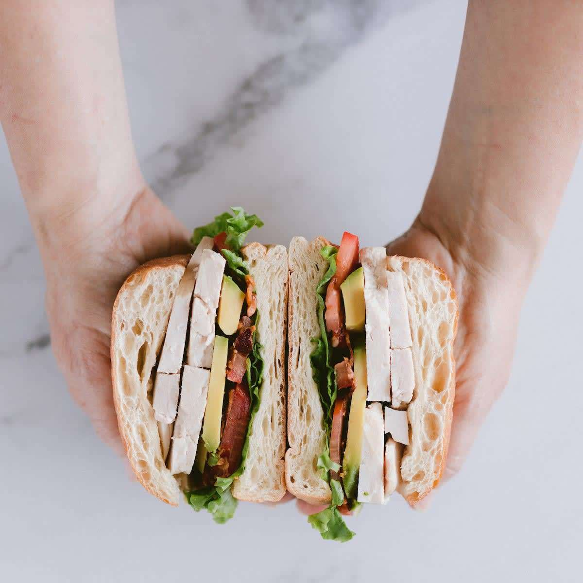sandwich with hands