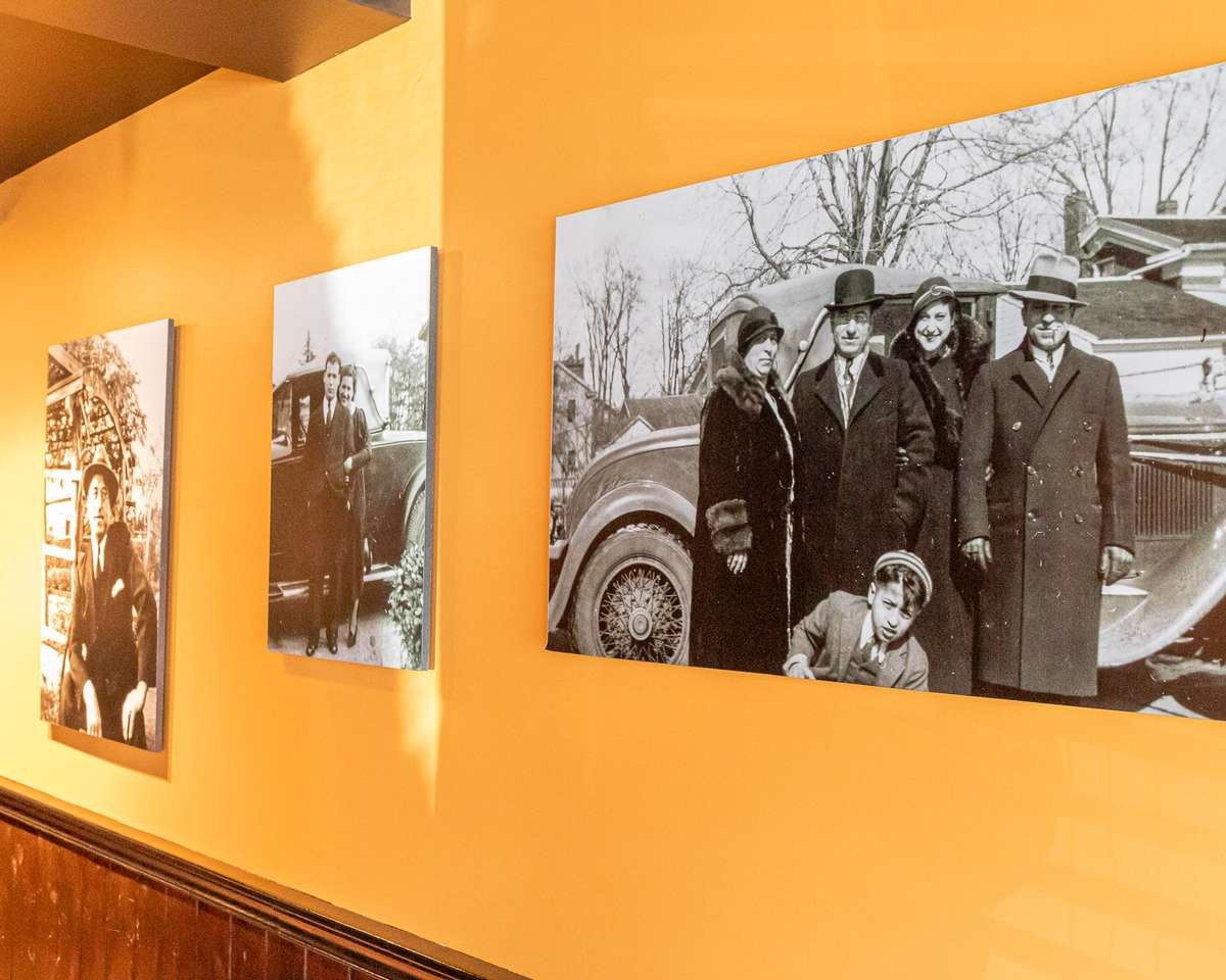 Our History header image of old black and white family portraits