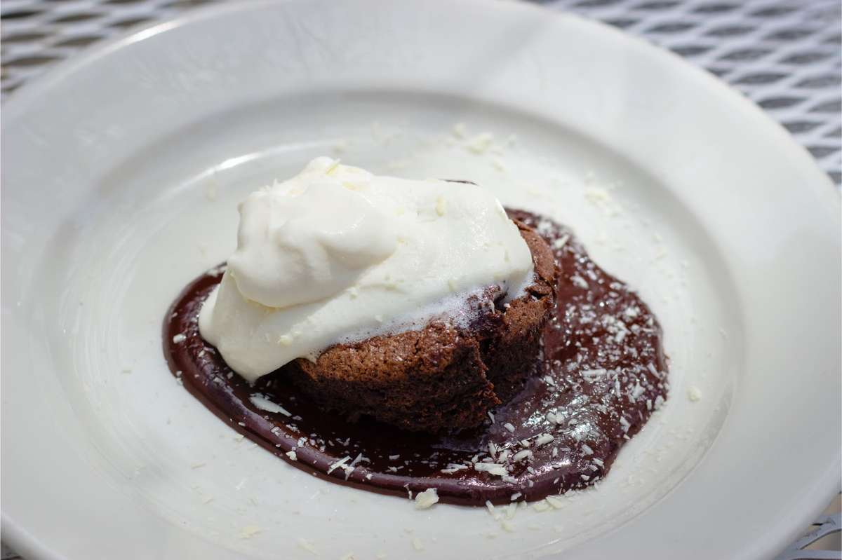 Warm Chocolate Soufflé with Chocolate Ganache, White Chocolate Shavings and House Whipped Cream (local)