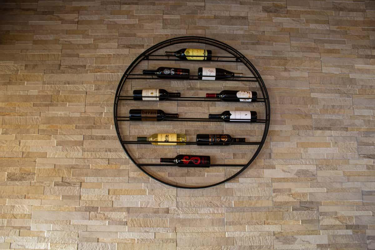 Circular wine wrack mounted on wall