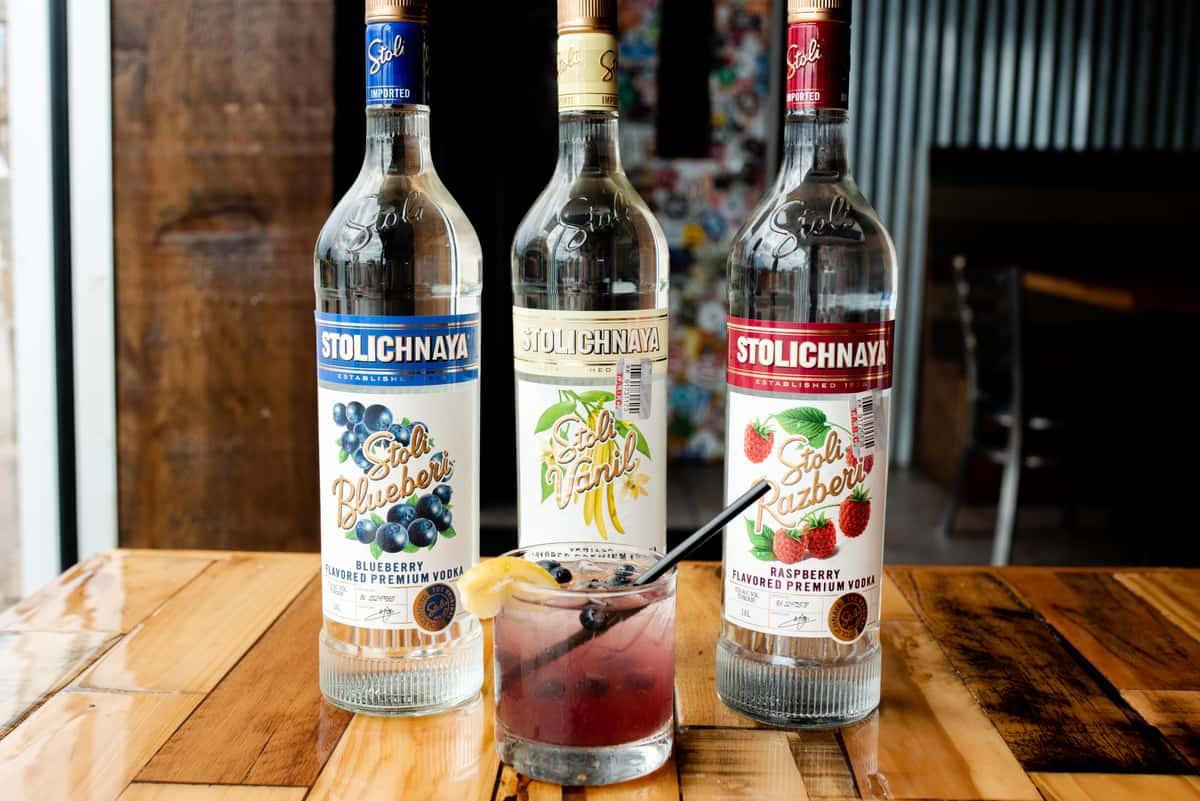 liquor bottles and custom cocktail