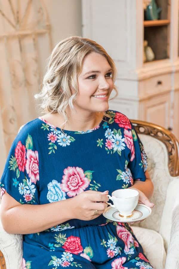 bridesmaid holding teacup