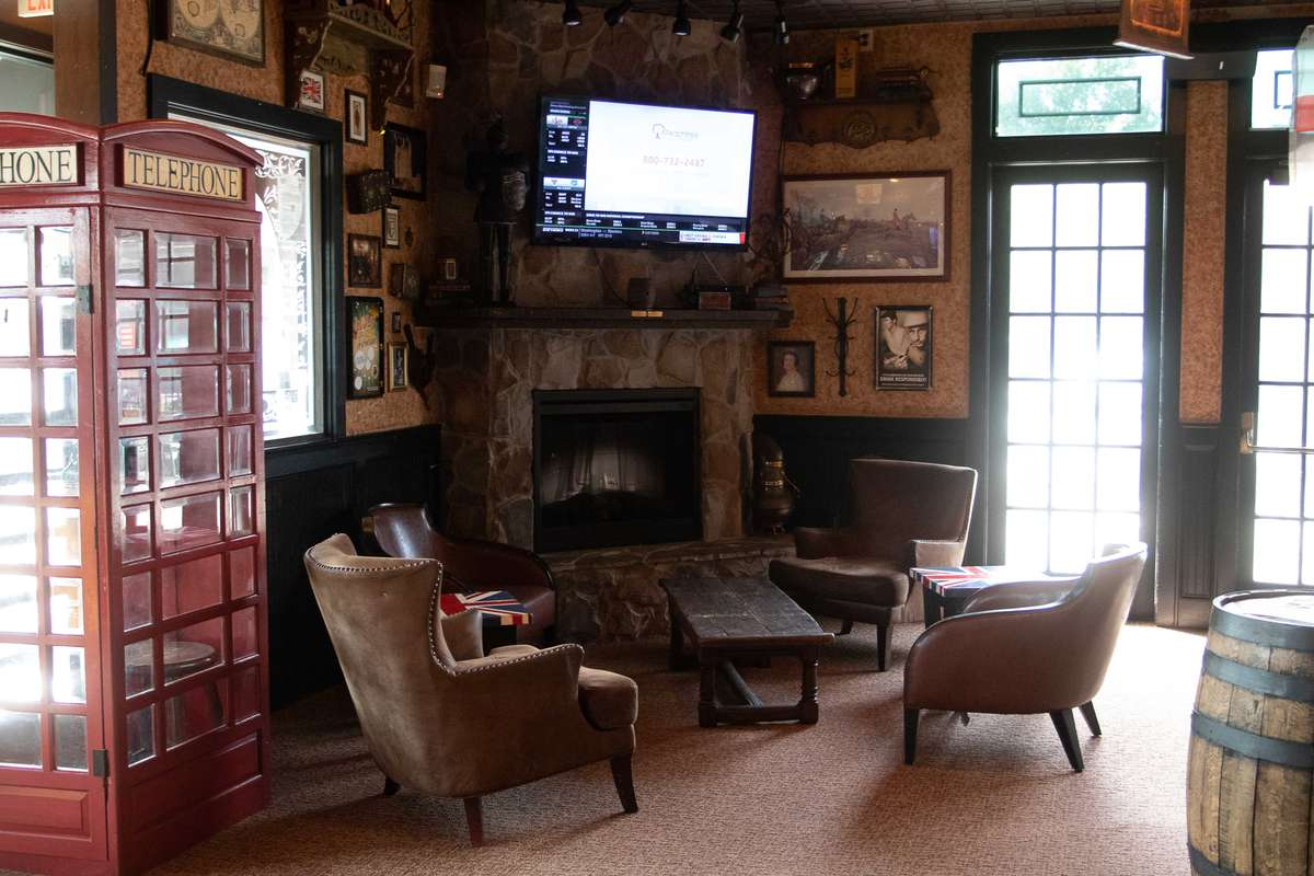 Old English style lounge with fireplace and seating