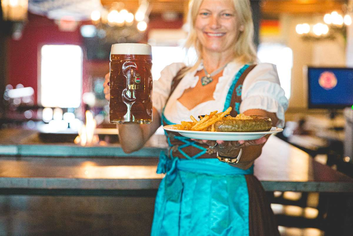 waitress with sausage and beer
