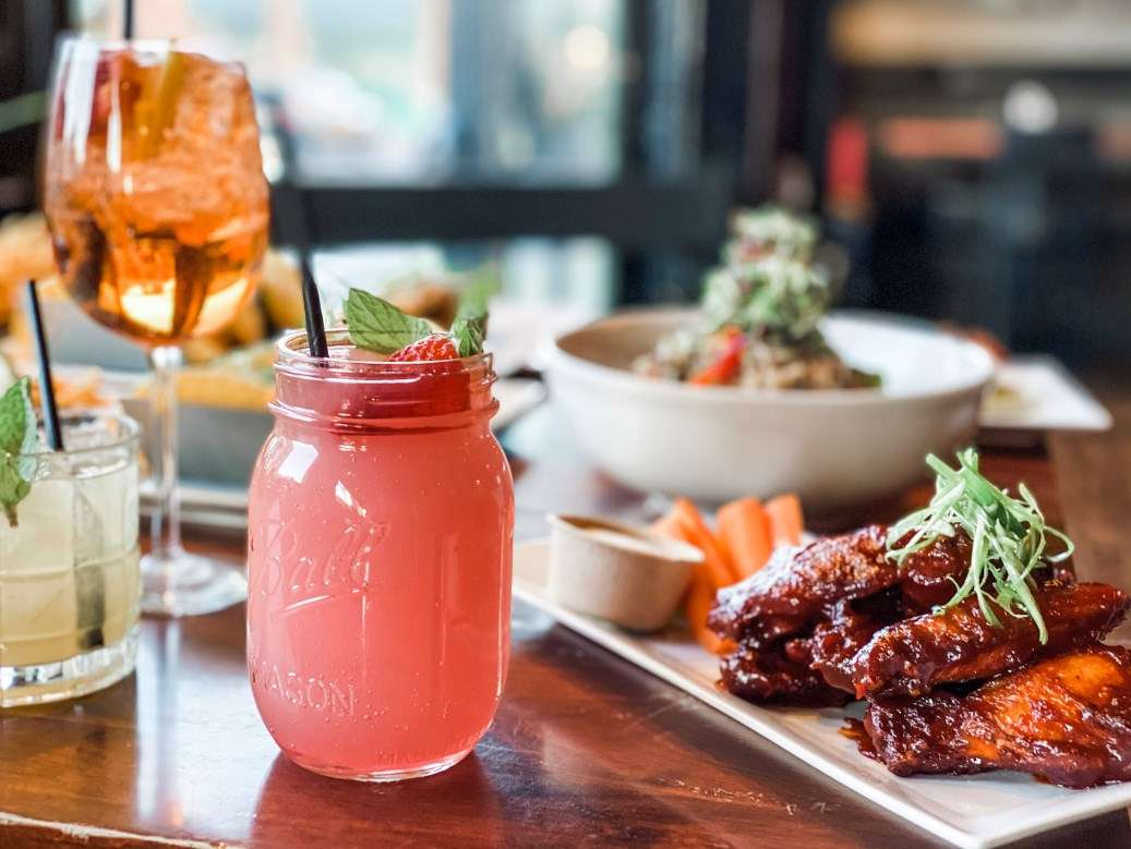 wings with strawberry beverage