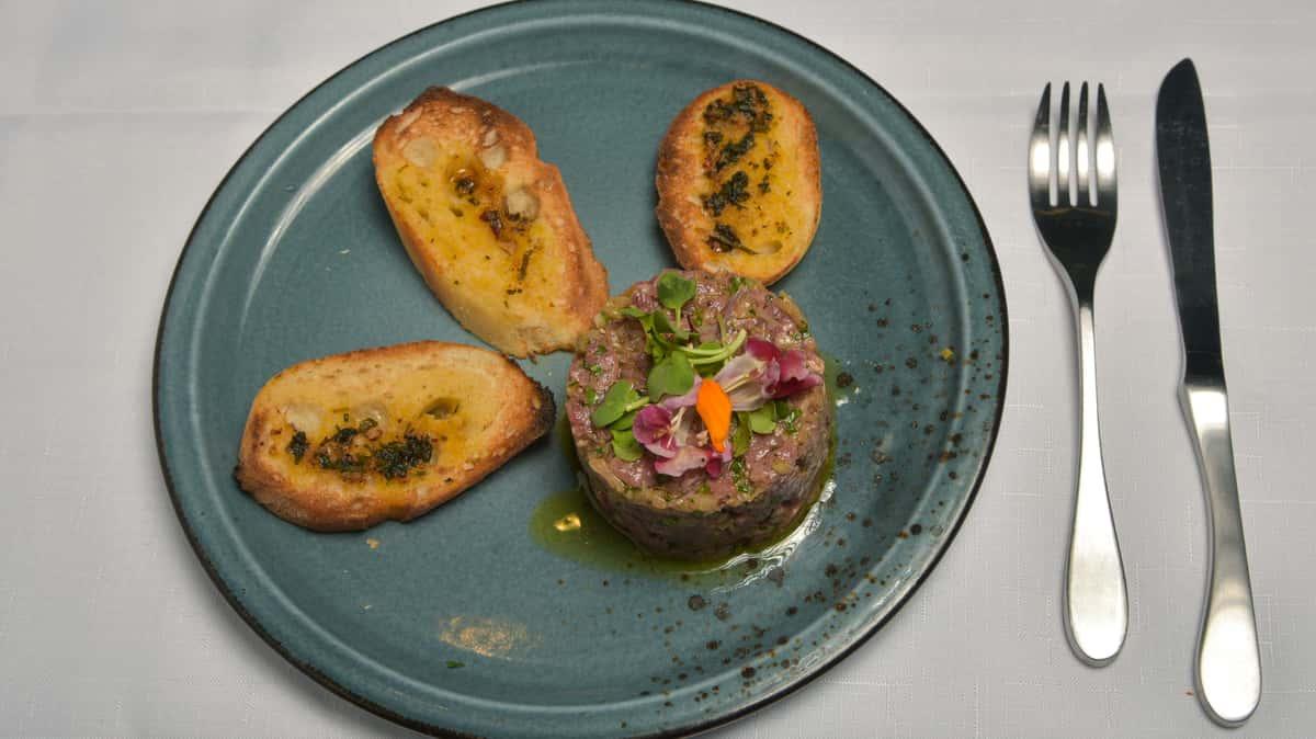Beef Tartare Crostini, Caper Dijon Vinaigrette, Pickled Shallots
