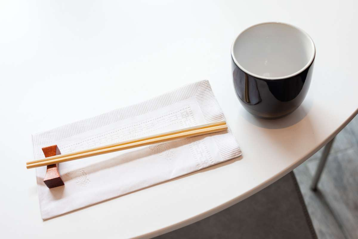 Place setting with chop sticks and a cup