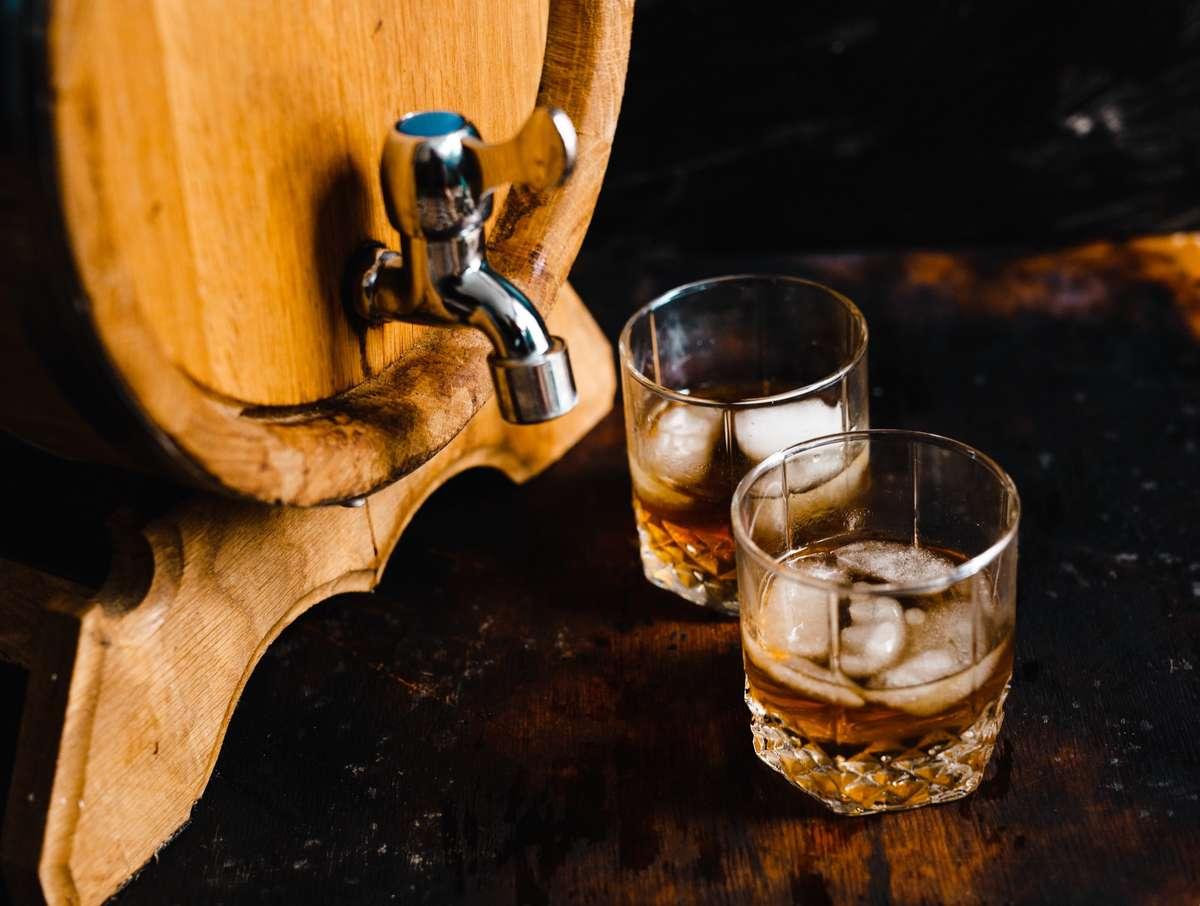 Whiskey barrel and shot glasses