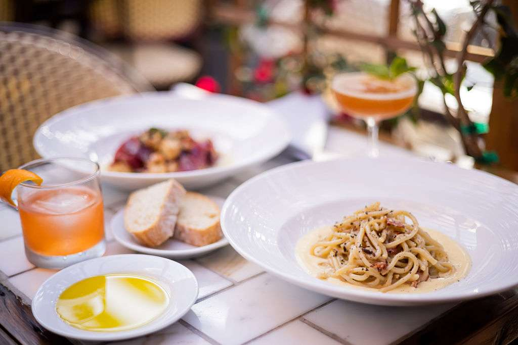 Italian meal with cocktails