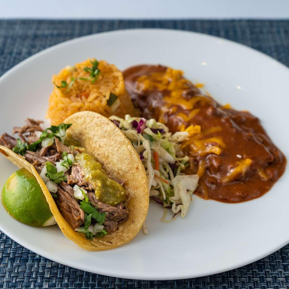 5. tejano enchilada, brisket taco, mesero slaw, arroz rojo