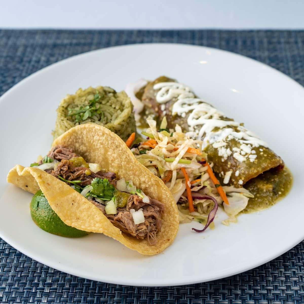 4. verdes enchilada, brisket taco, mesero slaw, arroz verde