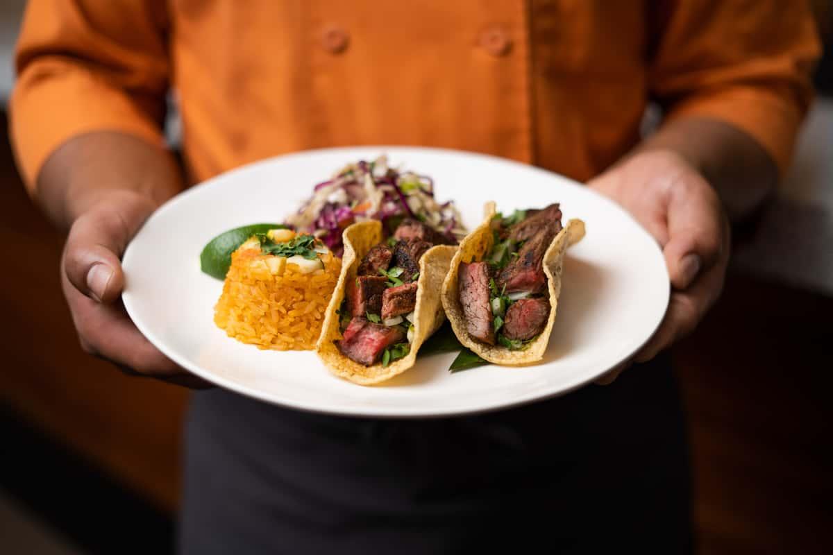 man holding tacos