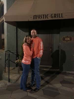 couple with Mystic Grill shirts