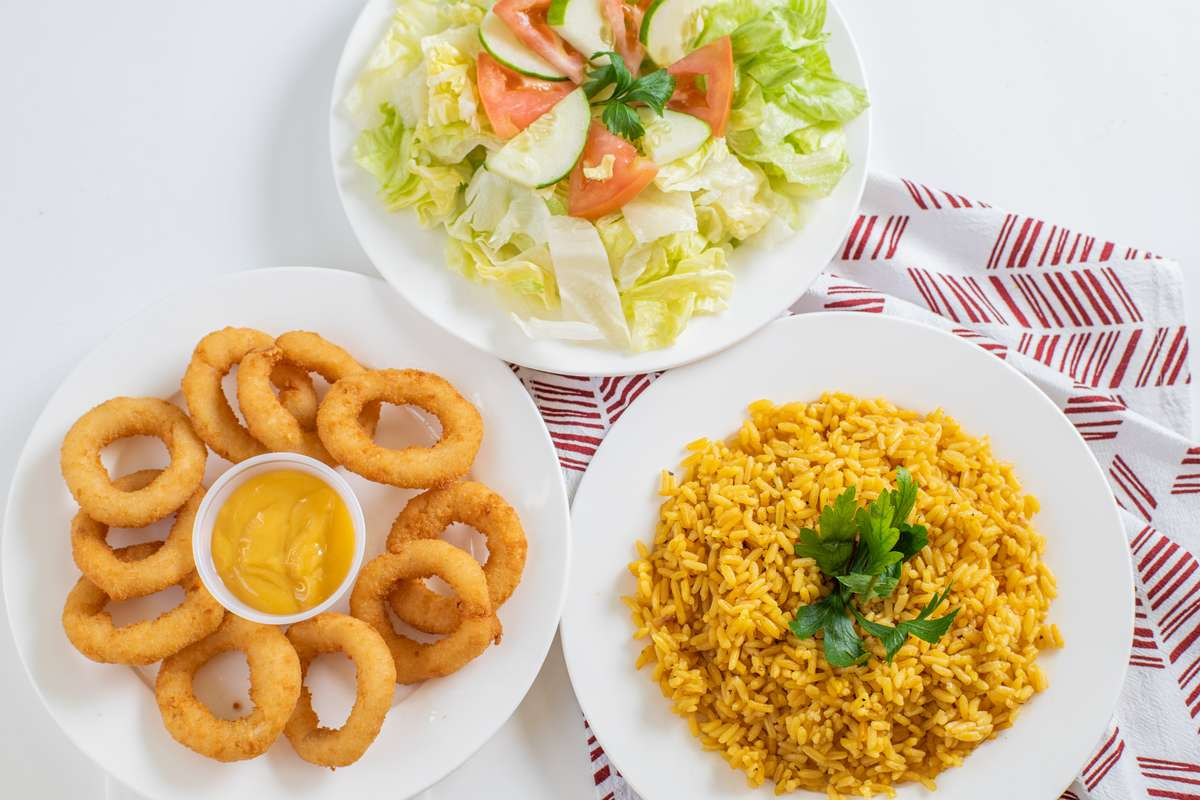 Rice, onion rings and salad