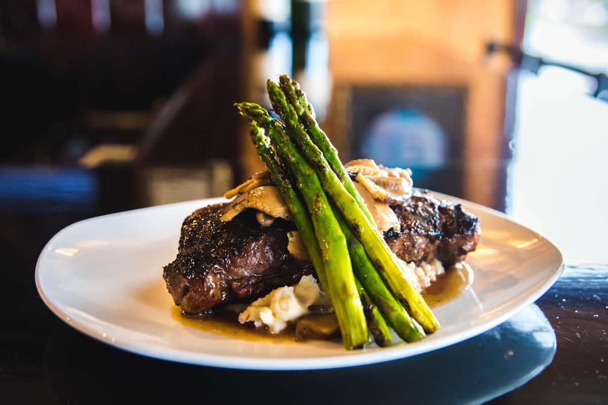 Grilled 12oz New York Strip Steak with sautéed local mushrooms
