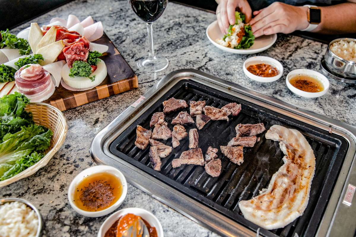 grill with meats and sides