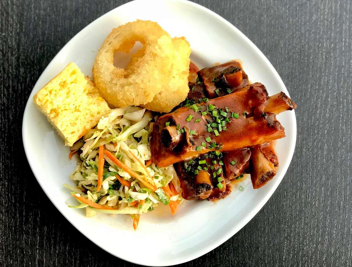 *BBQ Baby Back Ribs w/ Fried Onions, Cornbread & Sesame Peanut Coleslaw