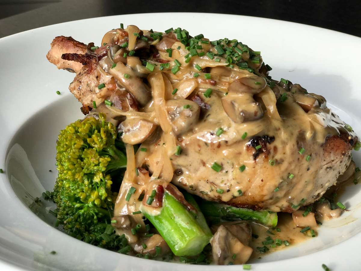 Pan Seared Pork Chop w/ Parmesan Scallion Risotto Cake, Broccolini & Mushroom, Bacon Cream Sauce