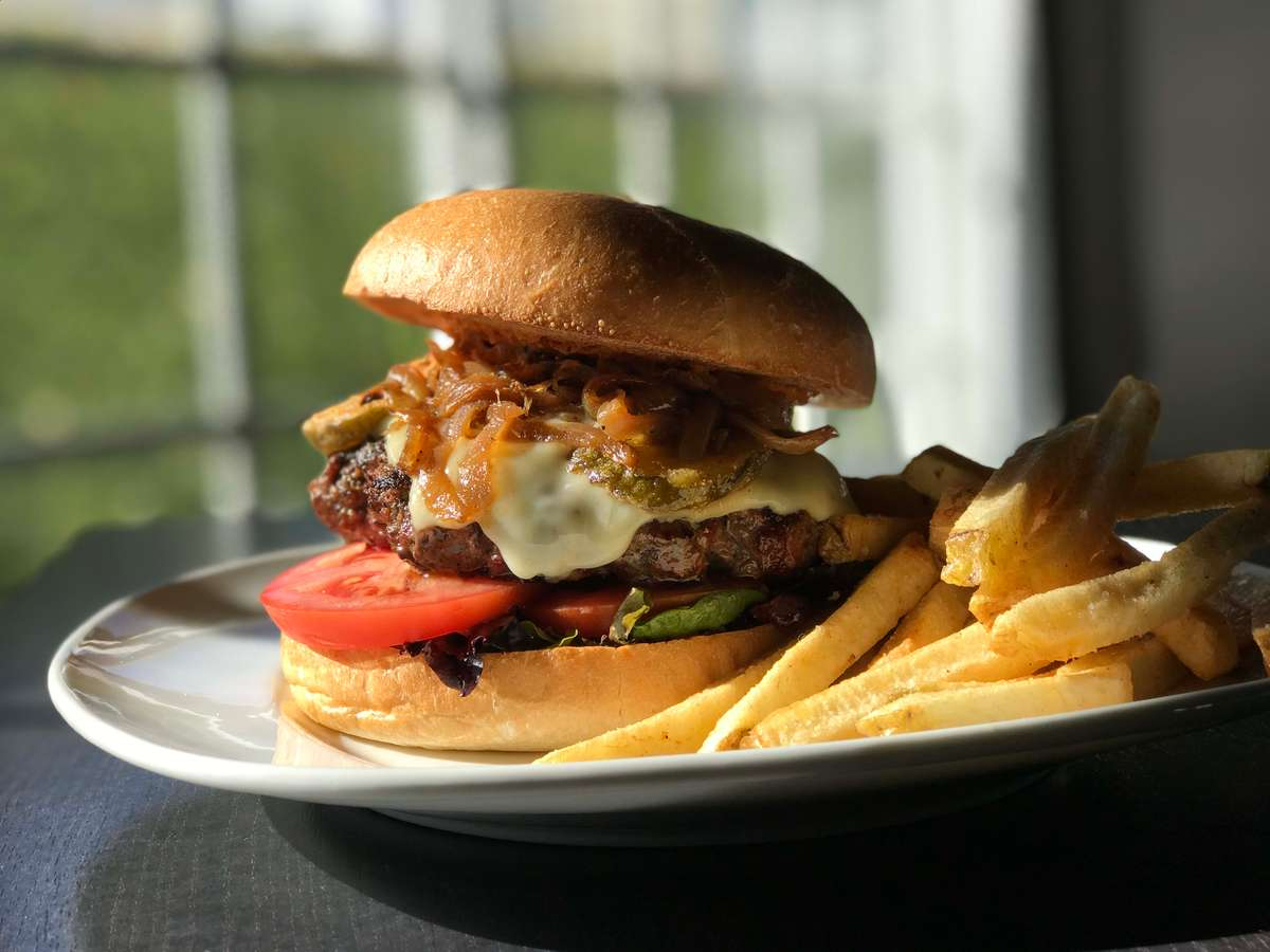 Char Grilled White Cheddar Burger w/ Caramelized Onions, Lettuce, Tomatoes, Fried Pickles & Hand-Cut Fries