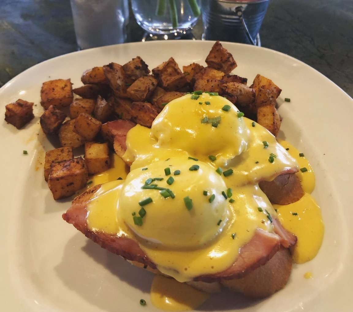 Honey Baked Ham Eggs Benedict w/ Poached Eggs, Hollandaise Sauce, and Roasted Potatoes