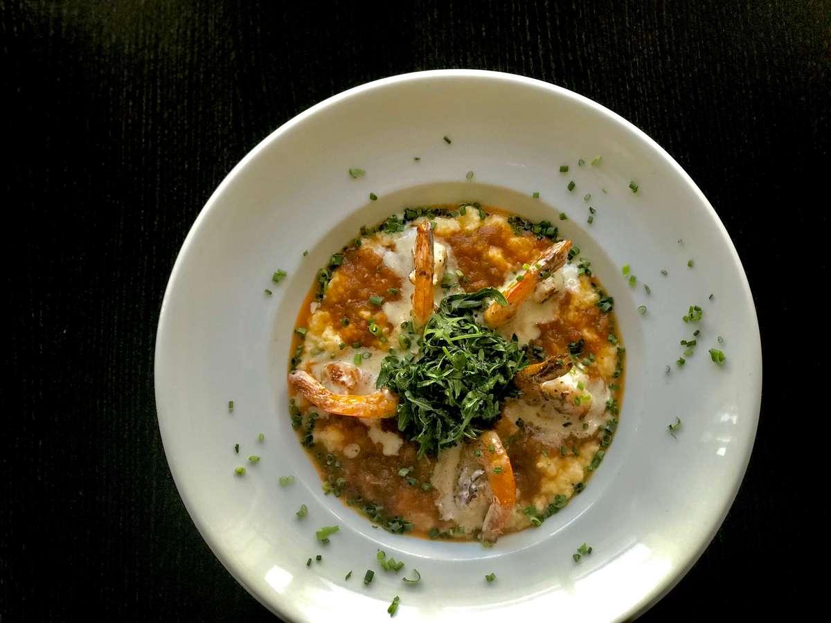 Southern Shrimp & Diver Scallops w/ Cheddar Jalapeño Grits, Sautéed Arugula & Lobster Gumbo Sauce