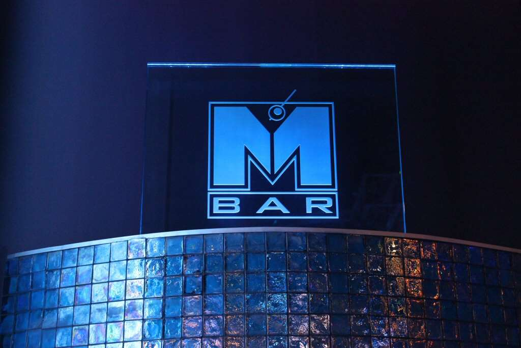 M Bar sign