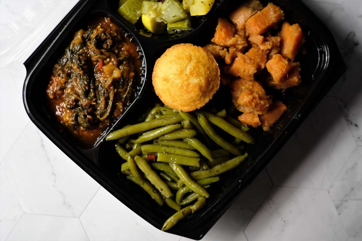 Vegetable plate with Fresh eggplant, squash and zucchini , sweet potatoes, green beans and corn bread.