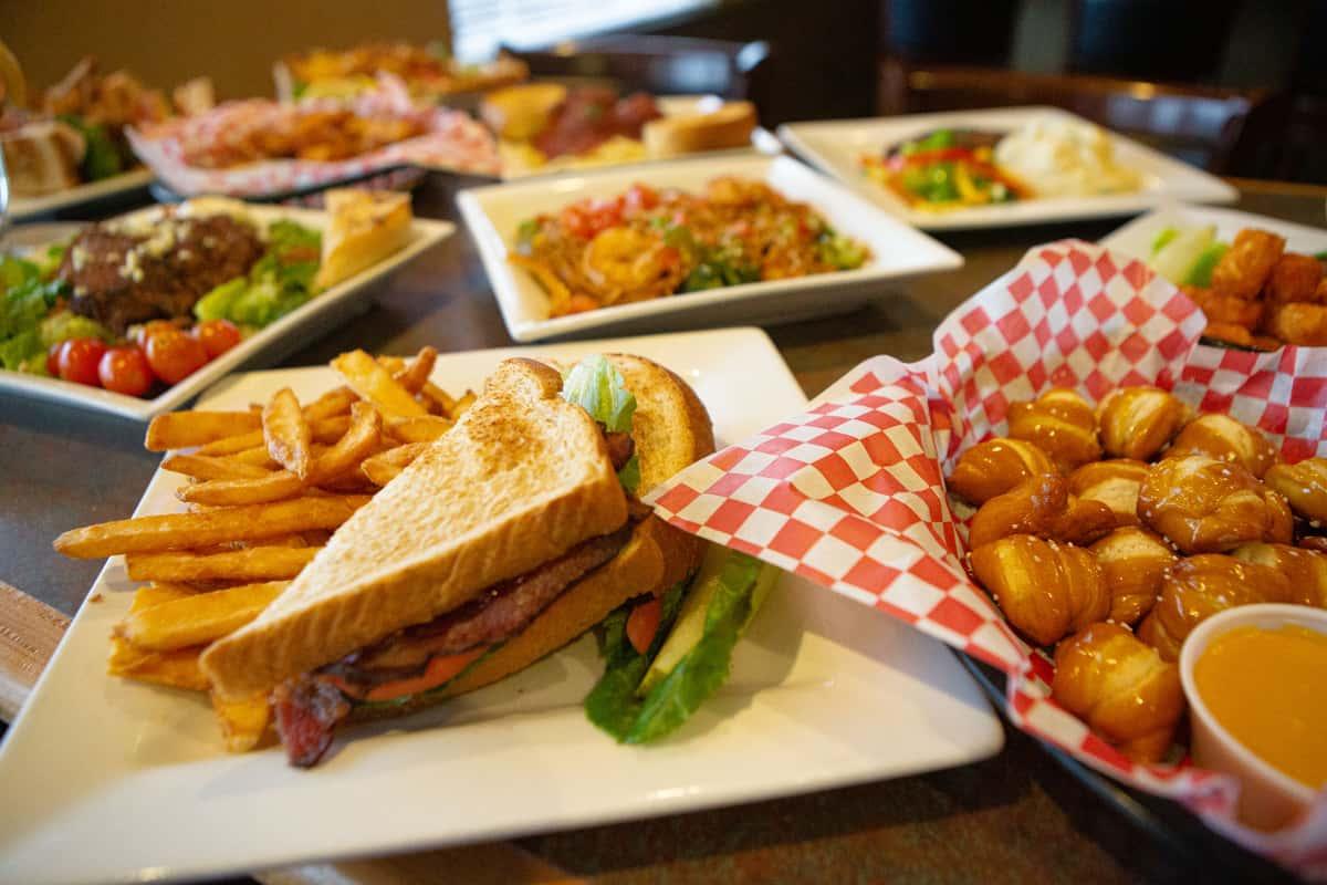 Food spread with sandwich and pretzel bites
