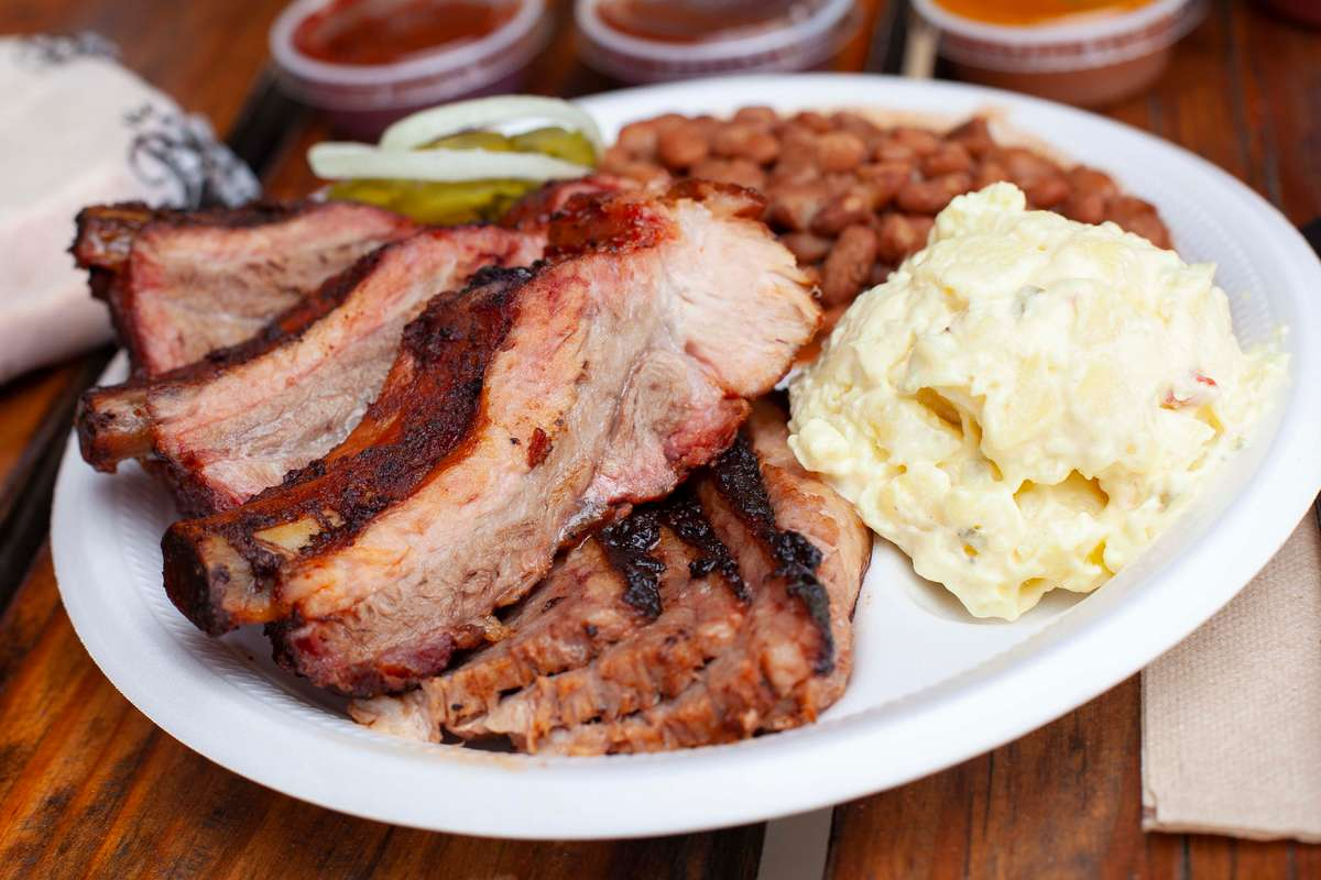 Baby Back Ribs plate with potato salad and pinto beans