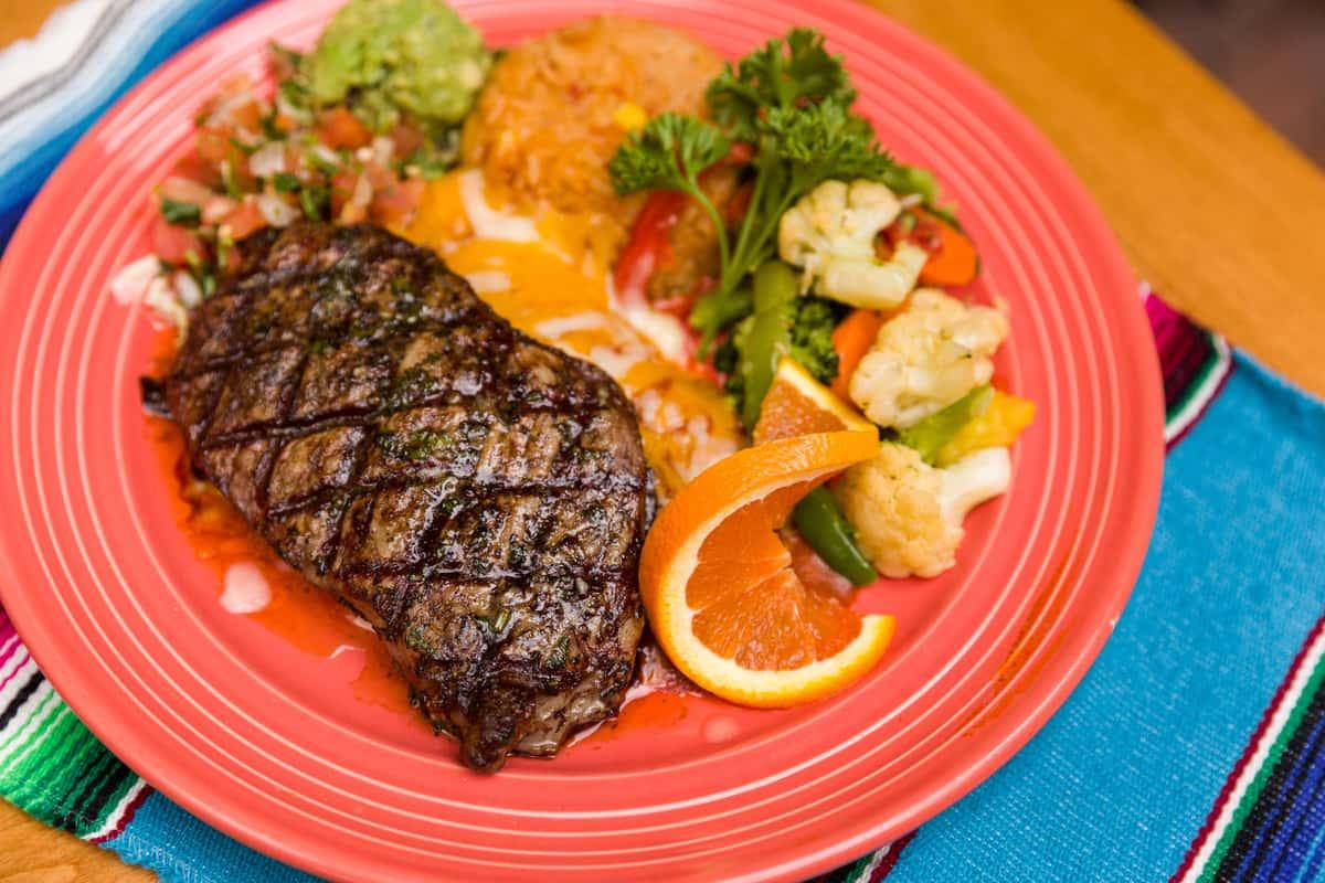 steak with orange slice