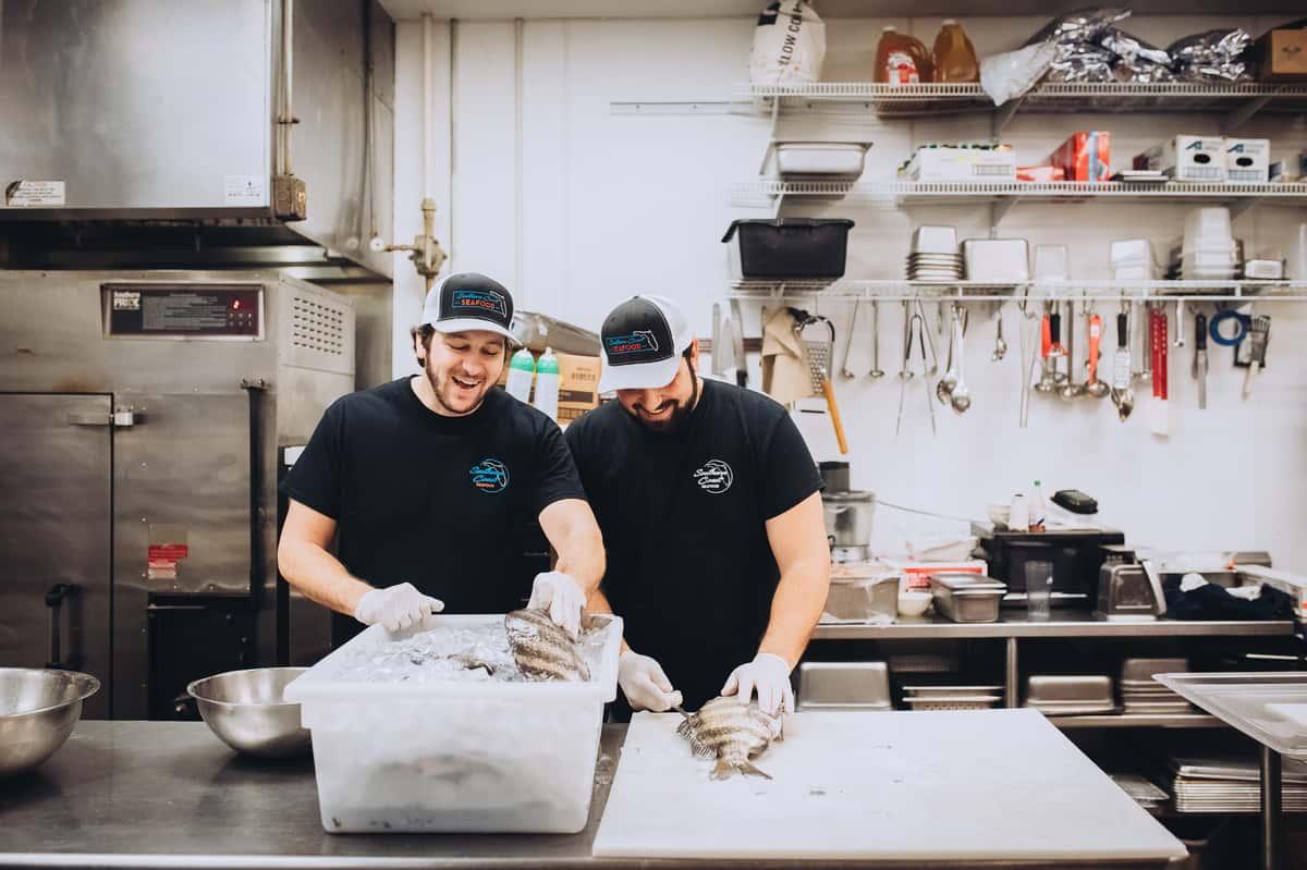 chefs preparing seafood
