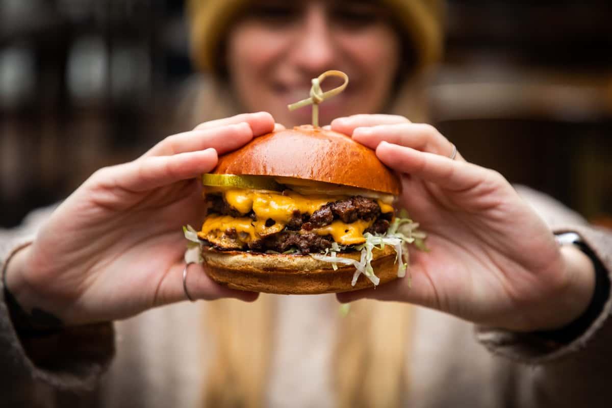 holding burger