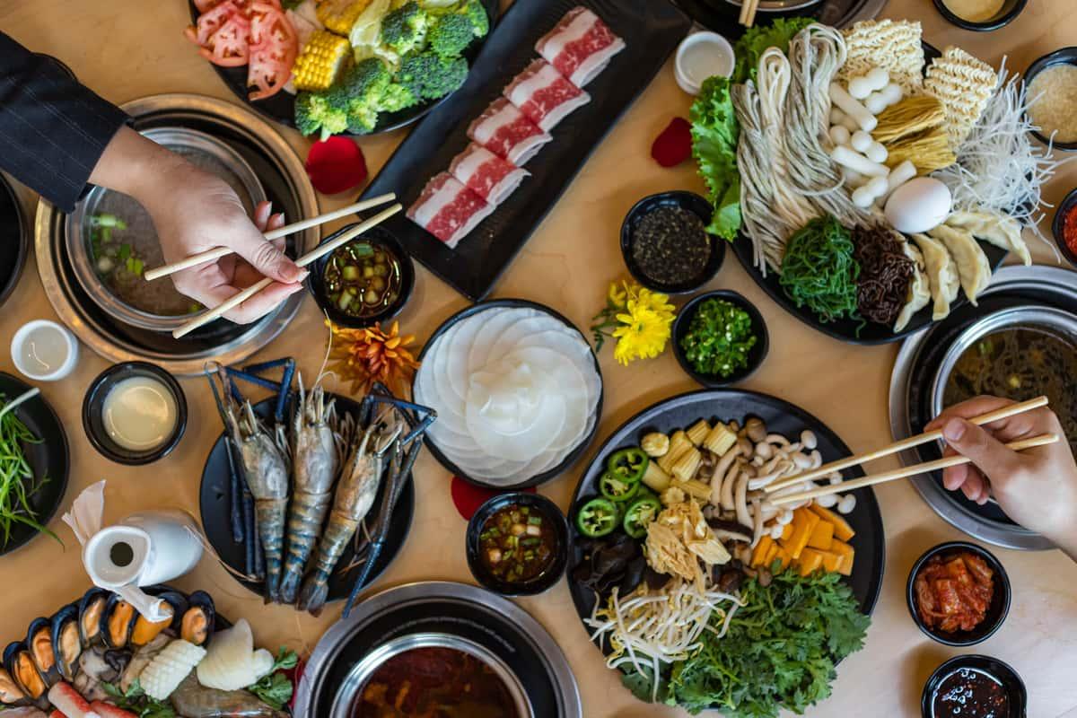 Two people eating shabu shabu together