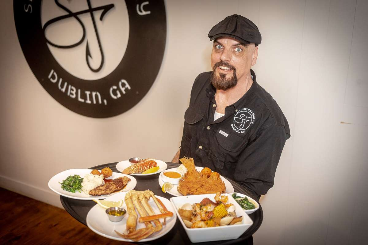 Waiter holding food tray
