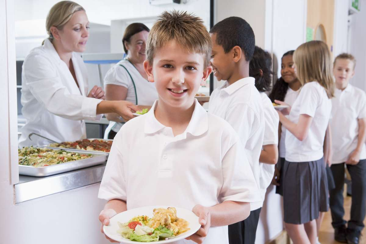child holding a plate of food