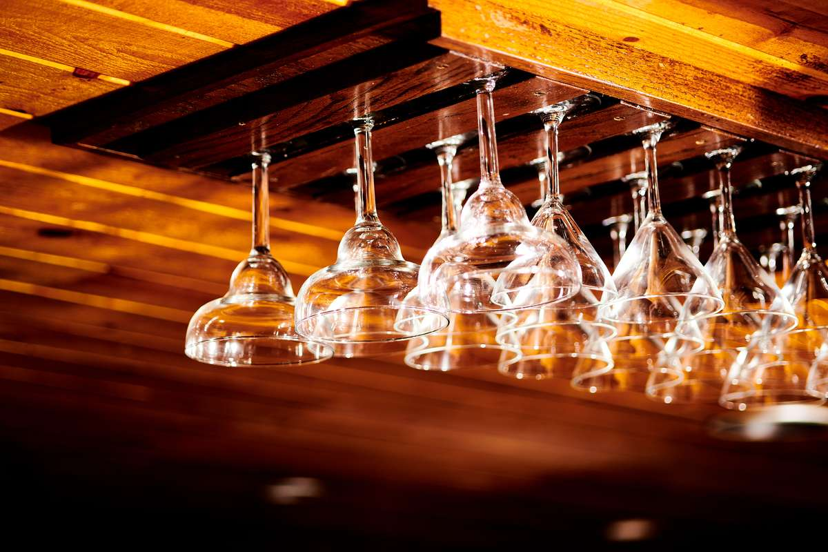 Wine glasses hanging from a ceiling