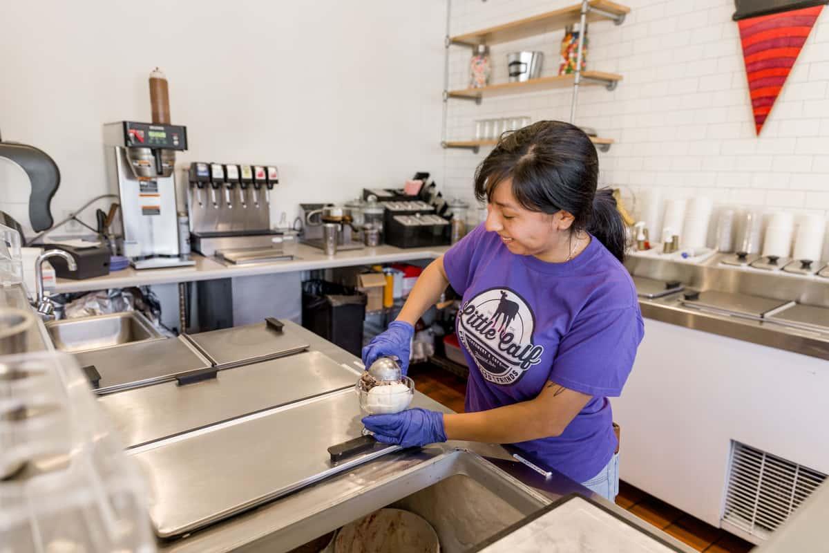 employee scooping ice cream