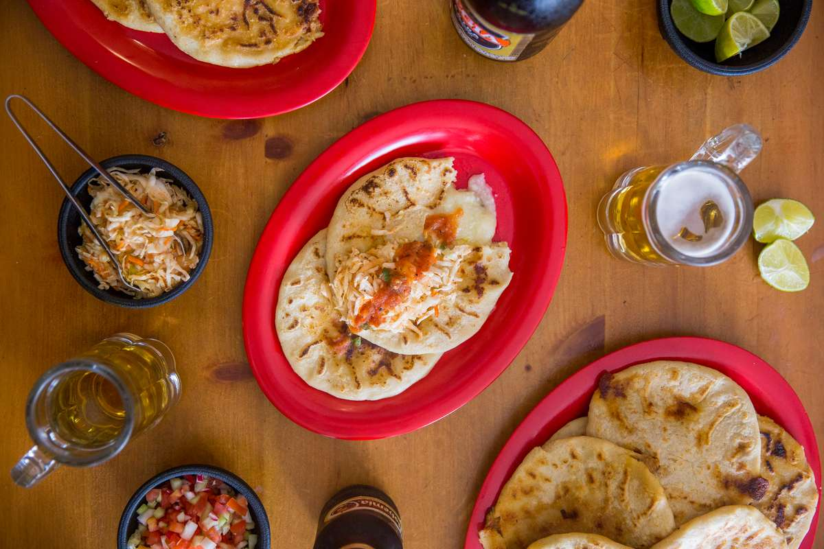 Aerial shot of pupusas and beer