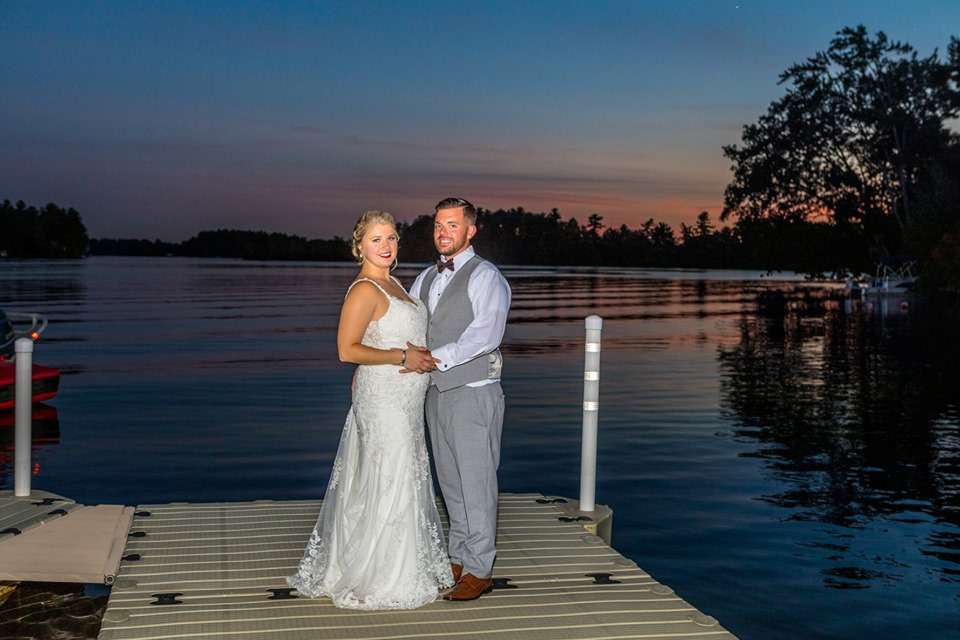 couple on dock at sunset